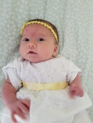 Sienna up close in her blessing dress.