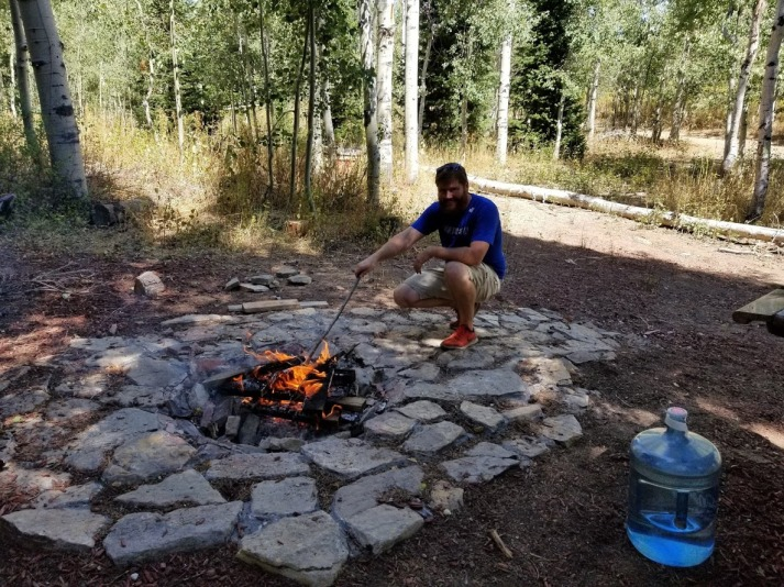 Josh building the fire on Labor Day.