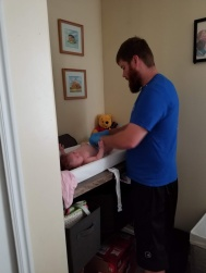 Josh changing her diaper and cleaning up her throw-up. It made me laugh so hard because he doesn't normally use gloves but he was grossed out by all the body fluids. It made me smile.