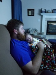 Daddy and daughter snuggling.